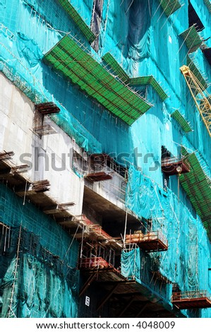 The scaffolding of Hong Kong's future tallest skyscraper, made out of cloth and bamboo. - stock photo