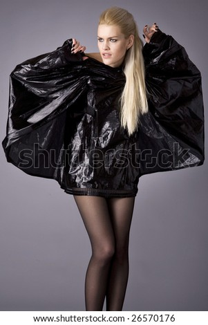 The scared girl is in black clothes - stock photo