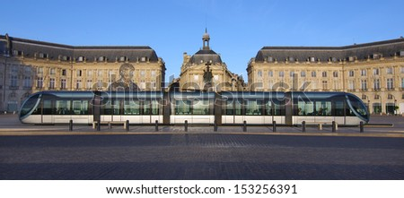 The scene shows the tram stopped at the place de la bourse in the city center of Bordeaux (France) - stock photo