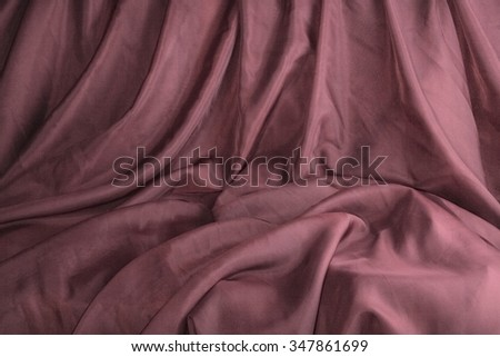 The scene variation of background with dark red cloth with chaotic folds. - stock photo