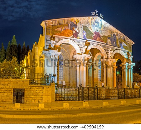 The scenic facade of the All Nations Church, decorated with beautiful mosaics in bright evening lights, Jerusalem, Israel. - stock photo