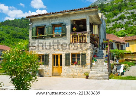 The scenic house located on embankment of Crnojevica river in Rijeka Crnojevica, Montenegro.