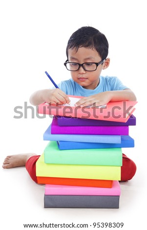 The schoolboy does his homework - stock photo
