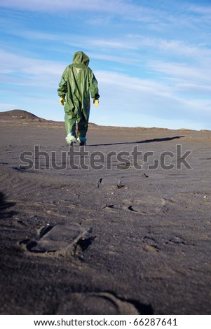 The scientific ecologist in overalls leaves afar - stock photo