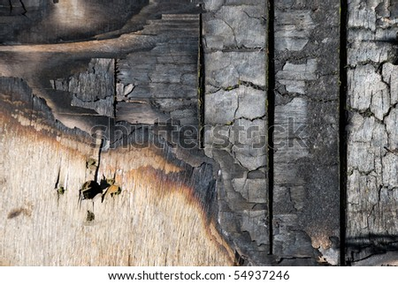 The scorched wooden background. - stock photo