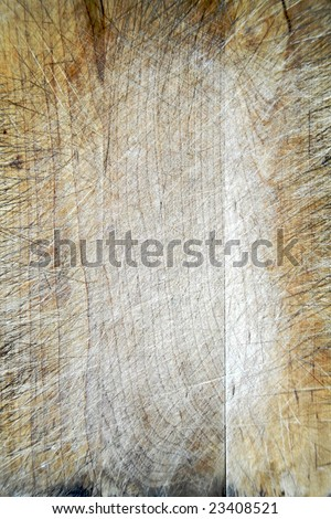 The scored surface of an old wooden chopping board - stock photo