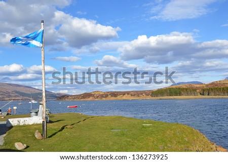 The Scottish Flag on the coast of the Isle of Skye, Scotland - stock photo