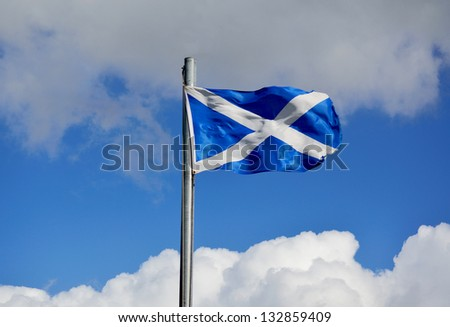 The Scottish flag (Saltire) flying on a windy day. Copy space.