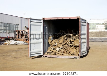 The scrap metal is in the open container - stock photo