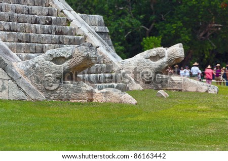 The sculpture at the base of the feathered serpent pyramid - Chichen Itza, Mexico - stock photo