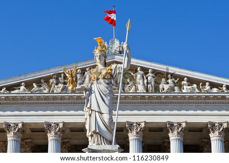 The sculpture is on the front side of the Austrian parliament building - stock photo