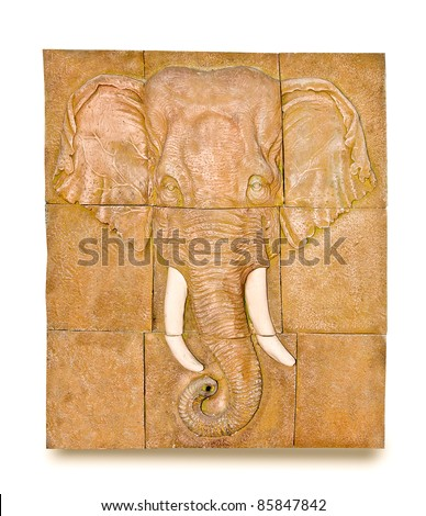The Sculpture of elephant on wall. This is traditional and generic style in Thailand. No any trademark or restrict matter in this photo. - stock photo