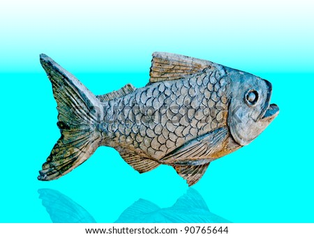 The Sculpture of fish on reflect background - stock photo