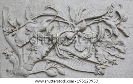 The Sculpture of flower decorative on the wall  - stock photo