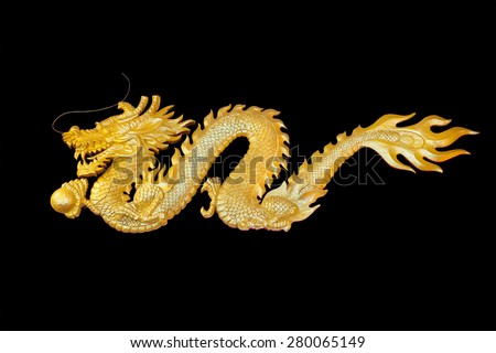 The sculpture of wooden fly golden dragon the symbolic of wealth and powerful in chinese belief isolated on black Background - stock photo