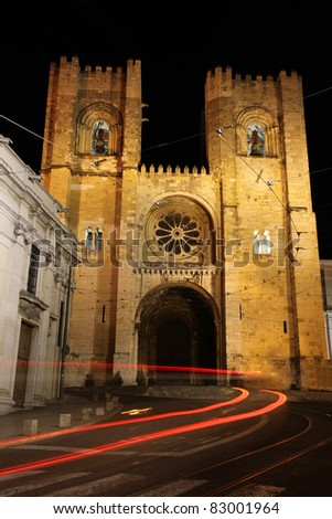 The Se, cathedral in Lisbon night shot with traffic blurs. This Cathedral is one of the famous landmarks in the Portuguese capital city of Lisbon and was constructed in the 12th century. - stock photo