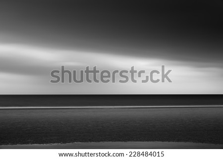 The sea and the coast with long exposure,black and white photo - stock photo
