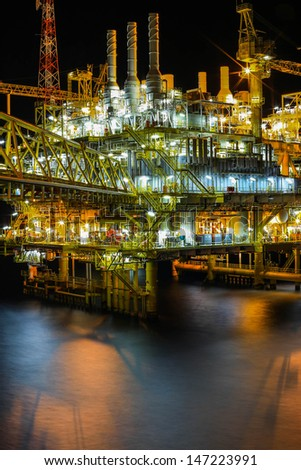 the sea gas rig night dark lights - stock photo