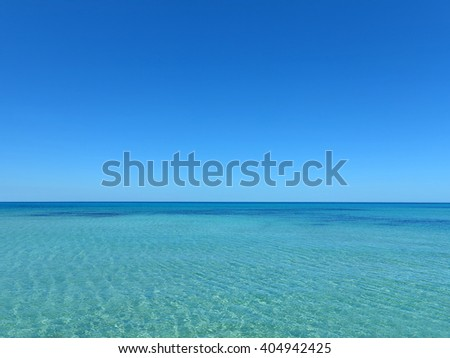 the sea in cyan and blue colors with rippled water an only low wind - stock photo