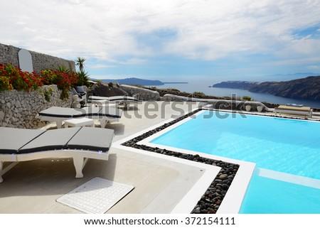 The sea view swimming pool at luxury hotel, Santorini island, Greece - stock photo