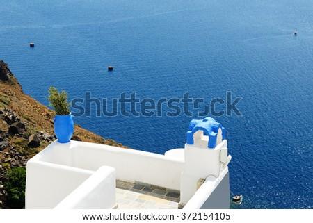 The sea view terrace and Aegean sea, Santorini island, Greece - stock photo