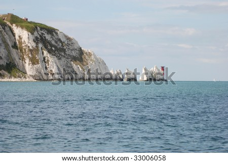 The sea, with the Needles rock formation on the Isle of Wight, England - stock photo