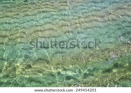 the seabed in the clear water view from above - stock photo