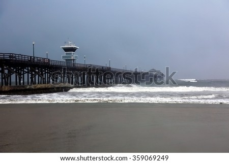The Seal Beach Pier in Southern California during the El Nino Storms of 2016 - stock photo