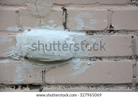 The seal on the brick wall- factor , showing the destruction of the wall - stock photo