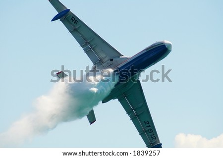 The seaplane Be200 shows dump of water on an air show - stock photo
