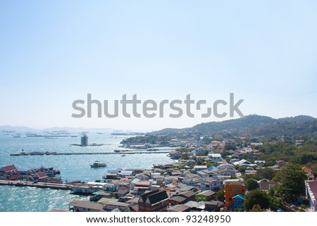 The seaside village on the island of Ko Si Chang ship at sea. - stock photo