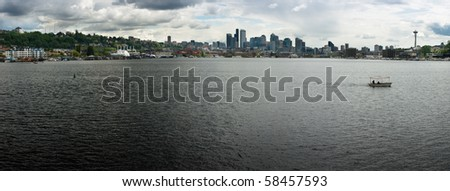 The Seattle skyline white white clouds and shoreline of Lake Union - stock photo