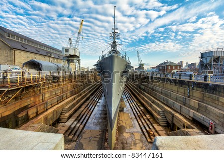 The second world war battleship Cassin Young in a dry doc for public exhibition in Boston, Massachusetts. - stock photo