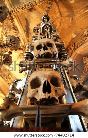 The Sedlec Ossuary is a small Roman Catholic chapel, located beneath the Cemetery Church of All Saints in Sedlec, a suburb of Kutna Hora in the Czech Republic. - stock photo