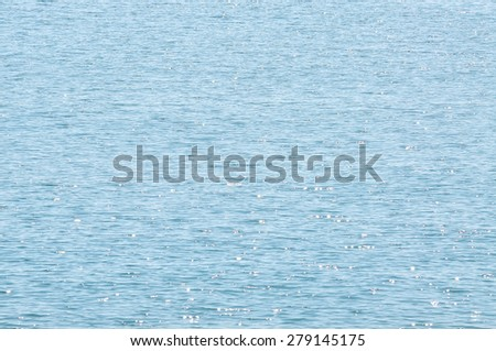 The Selective Focus Of Water surface with waves glittering in the sun with sun glares reflected - stock photo