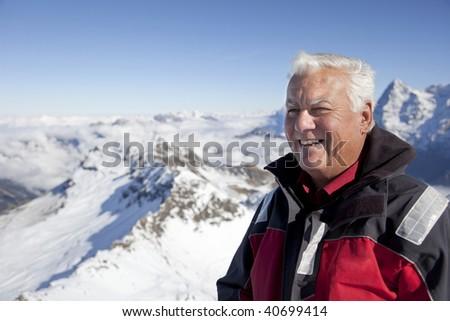 The senior man enjoy his travel on the Alps. - stock photo