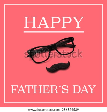 the sentence happy fathers day, and a pair black eyeglasses and a moustache forming a man face in a pink background - stock photo