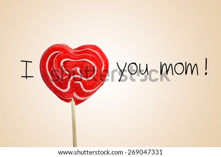 the sentence I love you mom with a red heart-shaped lollipop instead of the word love, on a beige background - stock photo