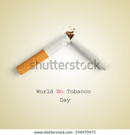 the sentence World No Tobacco Day and a broken cigarette on a beige background - stock photo
