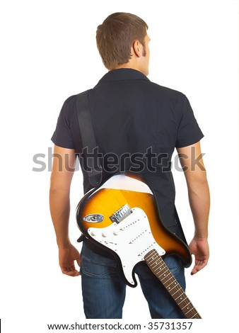 The serious beautiful guy with a guitar in a dark shirt - stock photo