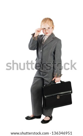 the serious girl in a business suit with a bag isolated on white