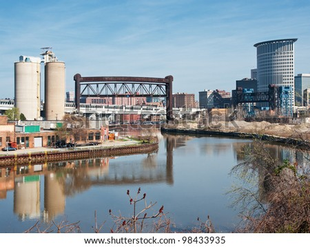The serpentine Cuyahoga River winds through the heart of the city of Cleveland, Ohio out to Lake Erie with commerce, industry,drawbridges, silos, seen along her shoreline - stock photo