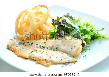 The sesoning fillet fish steak with oning rings