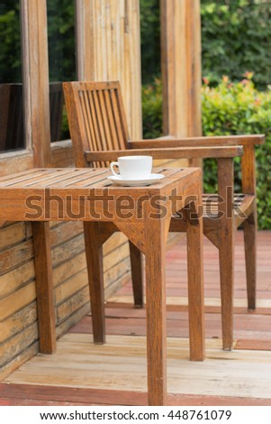 The set of wood furniture in the garden,small outdoor cafe in tropical garden