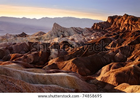 The Setting Sun Casts Oblique Light On Zabriskie Point, Death Valley National Park, California, USA - stock photo