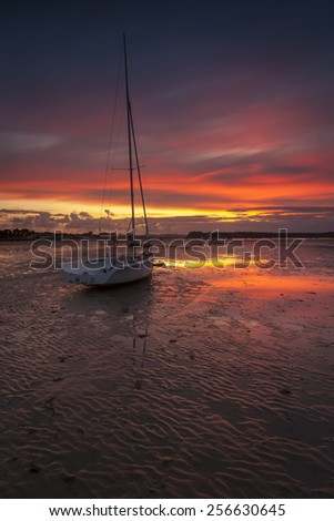 The setting sun illuminates the scene in one of the most beautiful areas of Dorset - stock photo