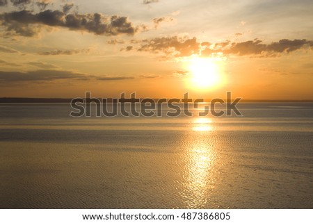 The setting sun in the Volga River, on the edge of the cliff