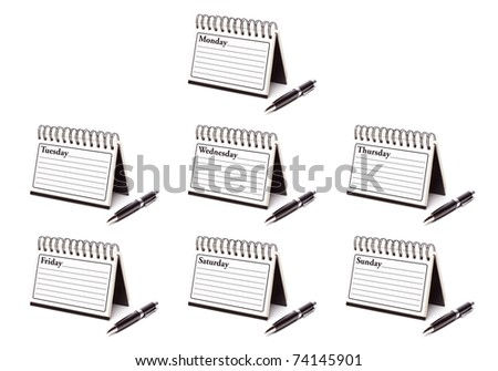 The Seven Days of the Week Spiral Note Pads and Pen Isolated on White - XXXL. - stock photo