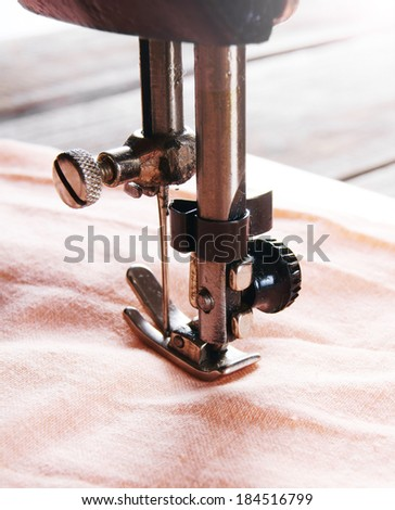 The sewing machine close-up. - stock photo