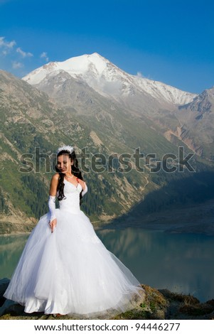 The sexy russian beautiful girl the bride in a wedding dress on nature - stock photo